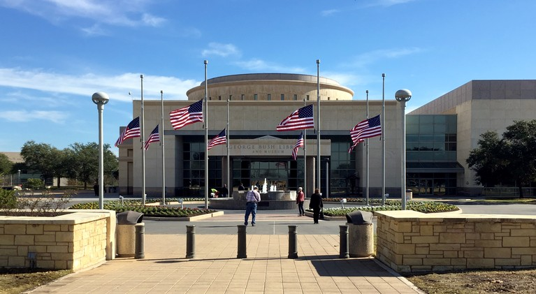 Flags Fly Half-Staff at Bush Library